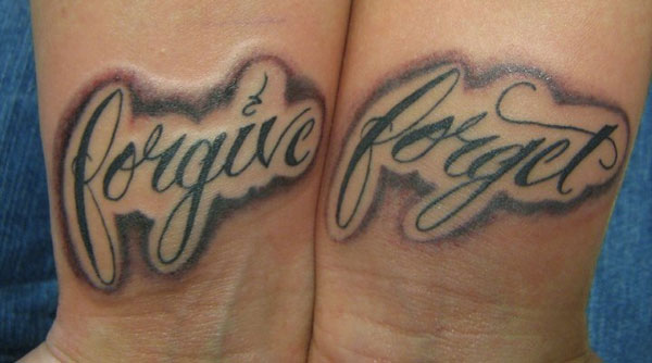 Forgive forget lettering tattoo