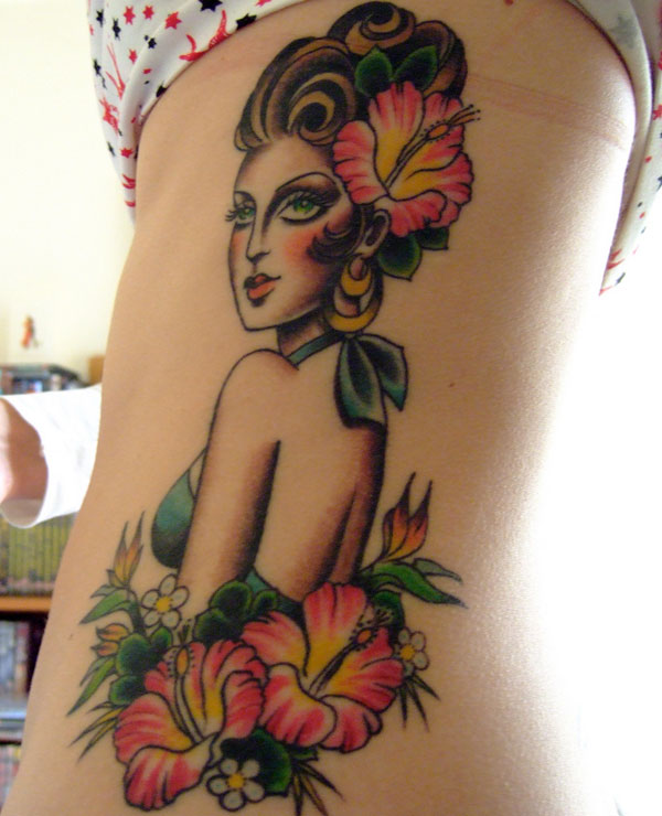 Hula girl tattoo on Ribs