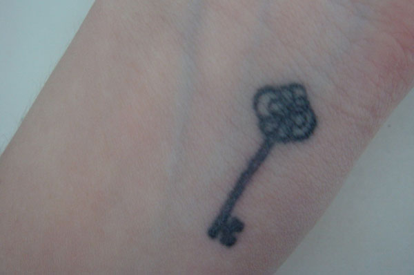 Key wrist tattoo