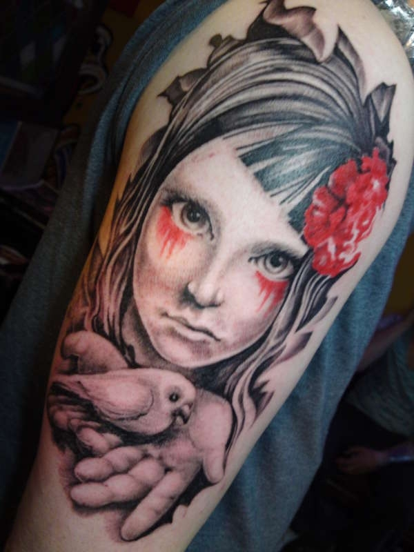 a cute cherub tattoo 30 Creative Female Tattoo Designs