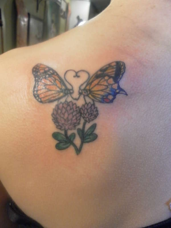 in love butterflies tattoo 30 Creative Female Tattoo Designs