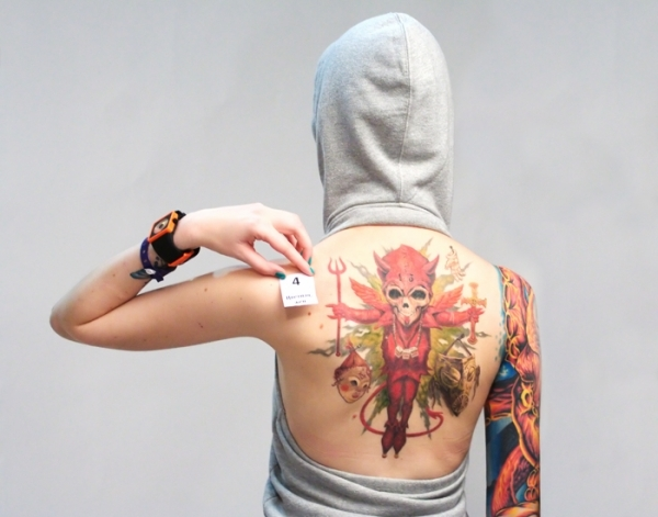 vibrant hell colour tattoo 30 Creative Female Tattoo Designs