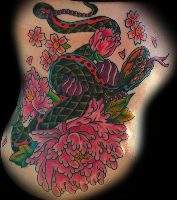 snake and flowers tattoo 50 Free Tattoo Designs Which Are Awesome
