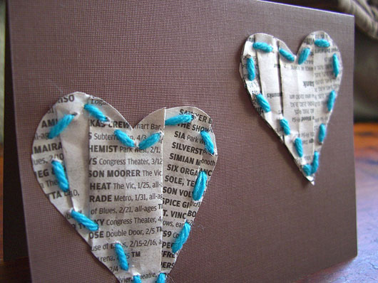 Folded newspaper and yarn valentine