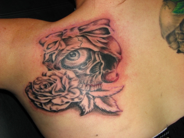 skull and rose 20 Girly Tattoos You Would Simply Love
