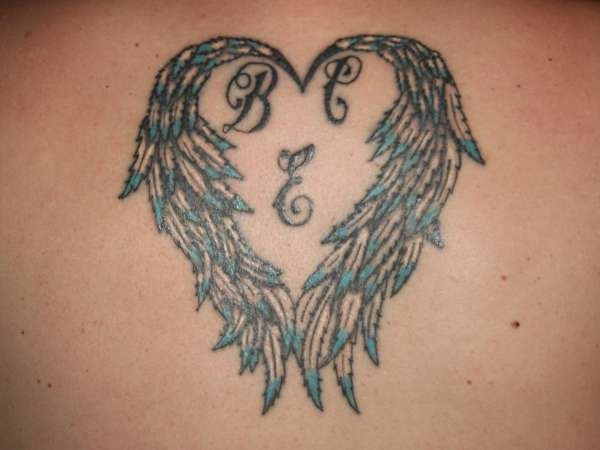30 awe inspiring heart with wings tattoos slodive rh slodive com Fallen Angel Wings Tattoo heart with angel wings tattoos