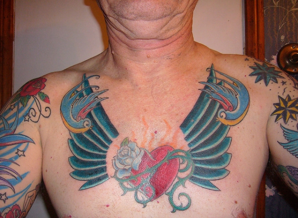 scared heart tattoo 30 Awe Inspiring Heart With Wings Tattoos