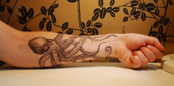 lower arm octopus 15 Amazing Octopus Tattoo Designs