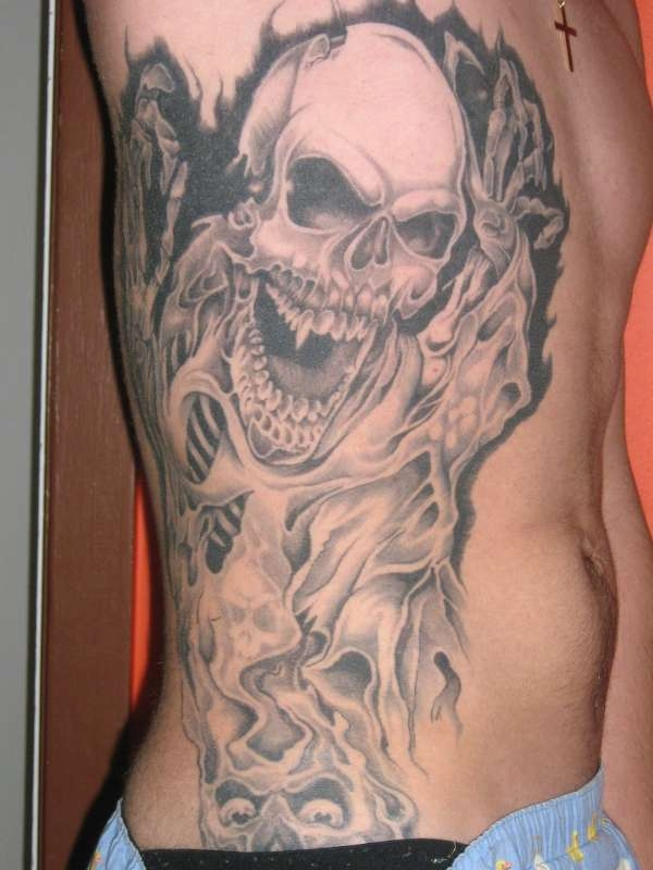 rib tickler tattoo 25 Marvelous Rib Cage Tattoos