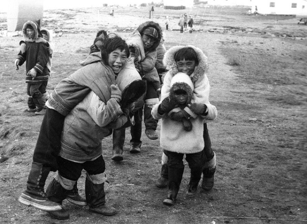 A Large Group Of Children Playing Outdoors