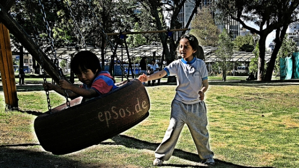 Latino Children Play Swing