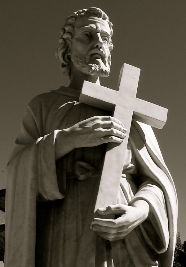 Statue Of A Saint Holding A Cross