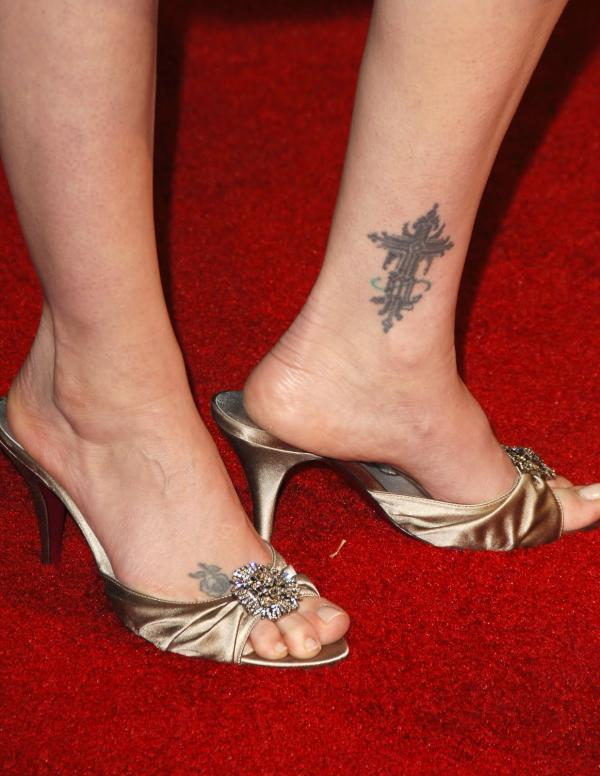 Virginia Madsen Cross Tattoo