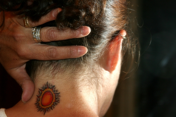 Sun Neck Tattoo