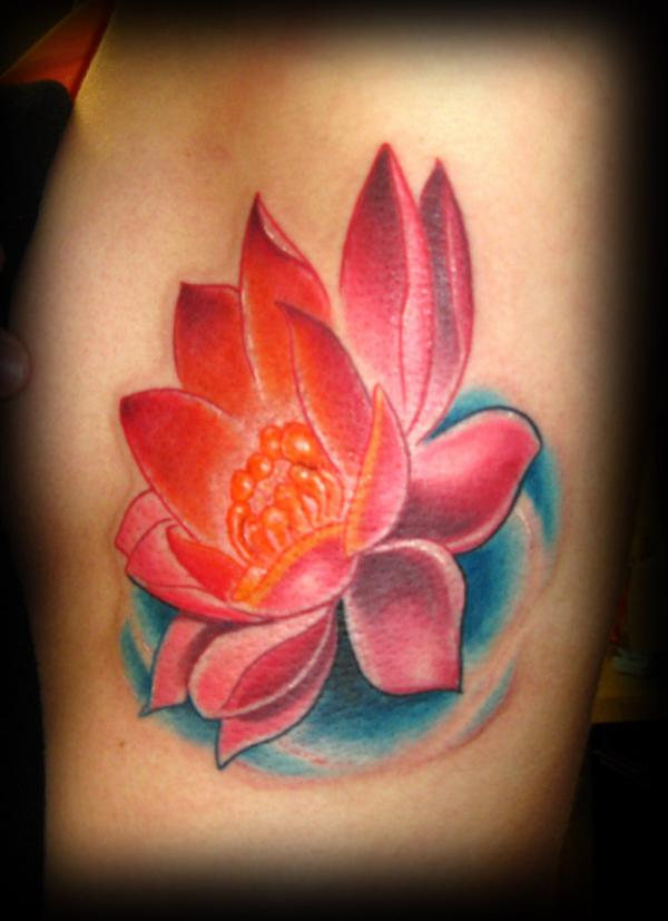 lotus on ribs 35 Lovely Lotus Flower Tattoos