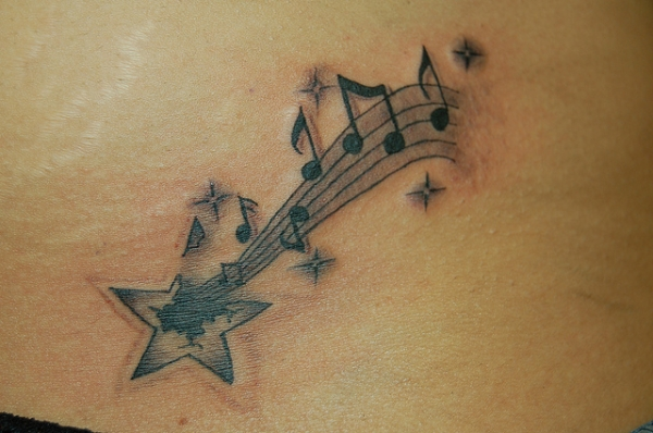 Shooting Star With Musical Notes Tattoo