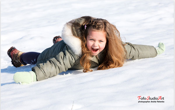Girl laying down in the snow