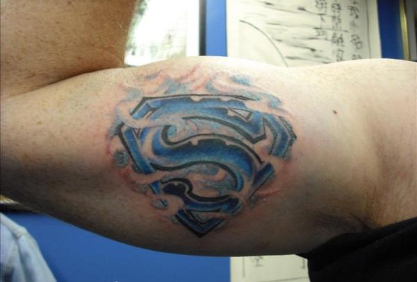 Superman Tattoo On Biceps