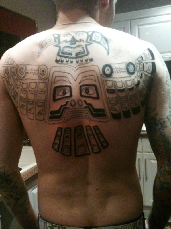 30 Cool Tribal Back Tattoos Slodive