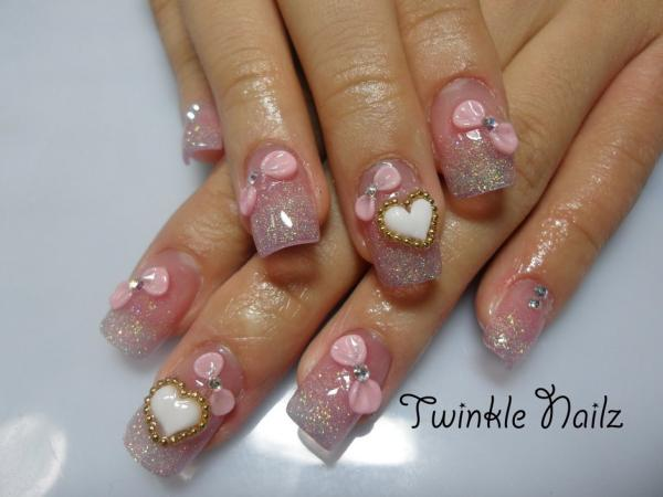 cute nails with hearts gems and lovely pink bows