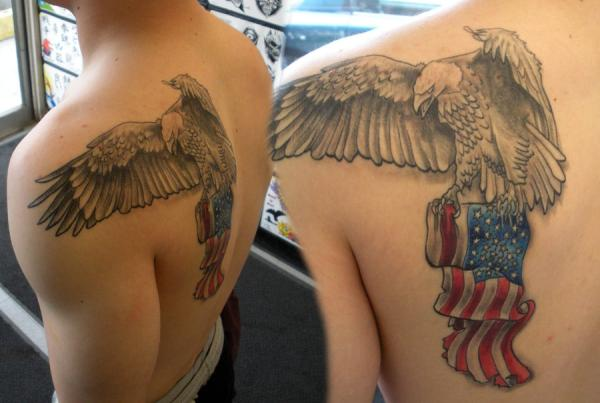 Proud Eagle Holding Flag Tattoo