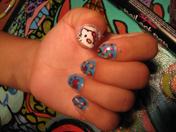 Cat Face And Claw On Nails