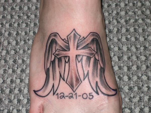 cross and wings foot 25 Glorious Cross With Wings Tattoo Designs