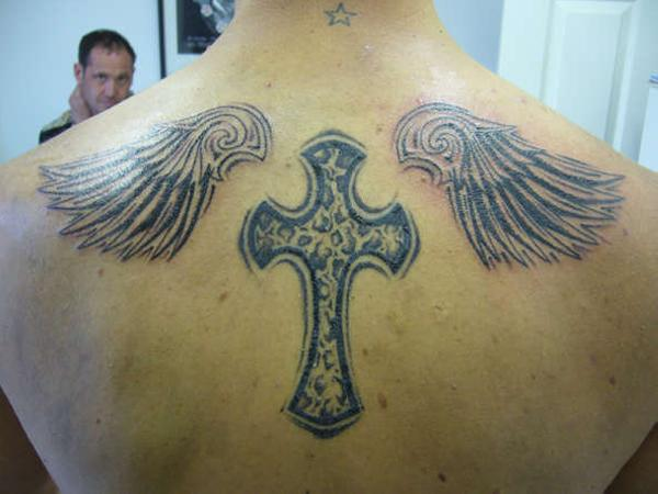 cross between my blades 25 Glorious Cross With Wings Tattoo Designs