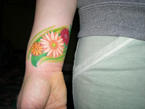 gerbera daisy on wrist 25 Gratifying Daisy Tattoos