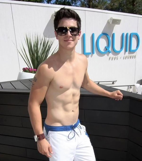 Side view of Bible quote tattoo on David Henrie's arm