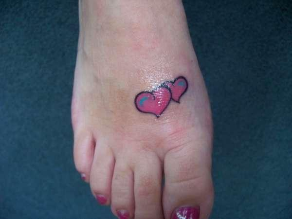 pink hearts on foot 35 Sexy Foot Tattoos For Girls