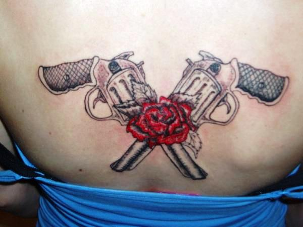 Flashing guns and a rose on her upper back here s a woman with killer