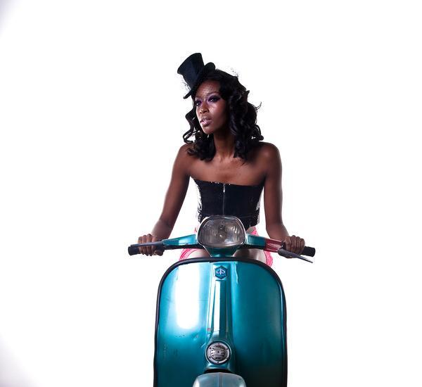 lady on scooter 25 Sexy Hairstyles For Black Girls
