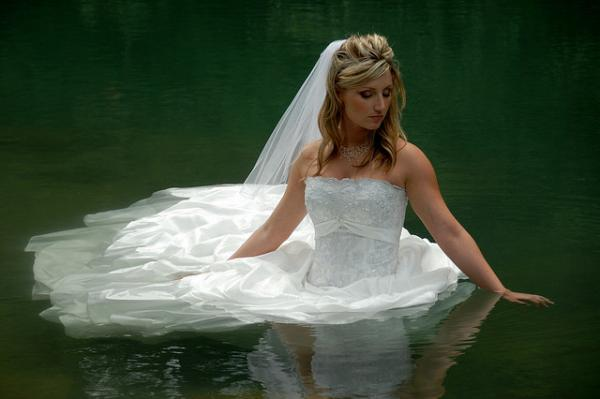 bride in water 30 Beautiful Half Up Half Down Wedding Hairstyles