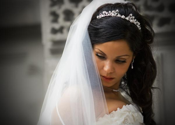 crowned bride 30 Beautiful Half Up Half Down Wedding Hairstyles