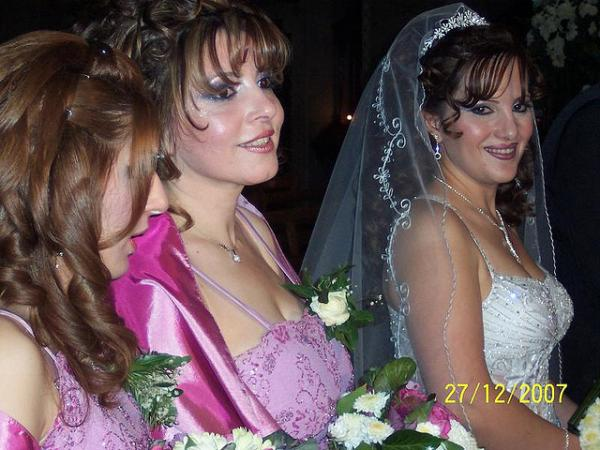 three brides standing 30 Beautiful Half Up Half Down Wedding Hairstyles