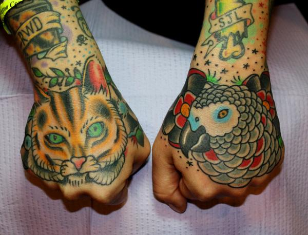 Cat And Parrot Hand Tattoo