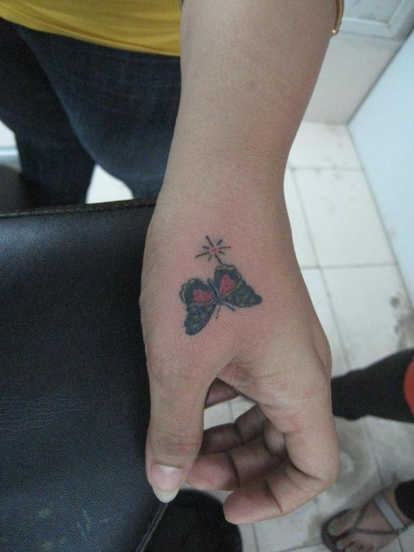 colorful butterfly 40 Awesome Hand Tattoos