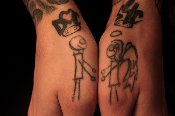 devil with angel 40 Awesome Hand Tattoos
