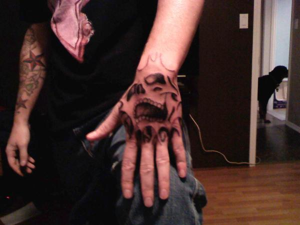 Ghost Hand Tattoo