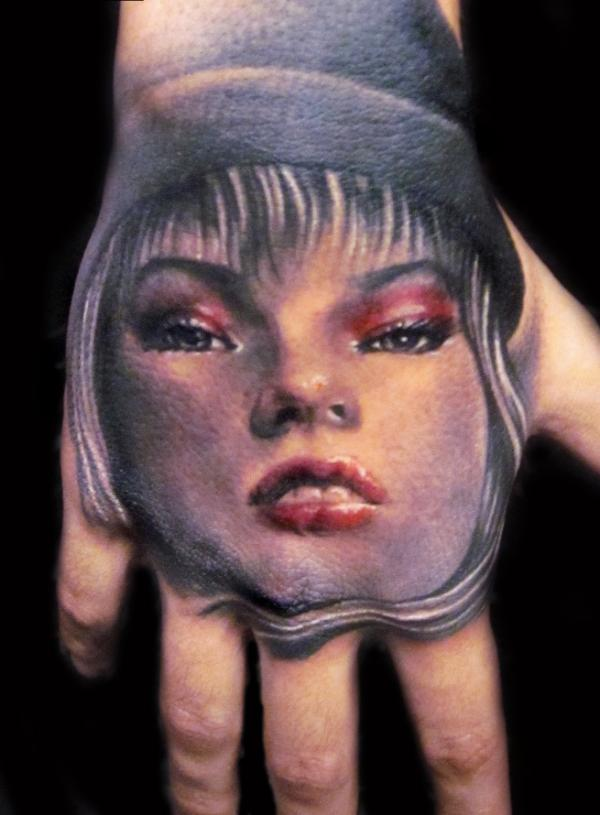 girl potrait 40 Awesome Hand Tattoos