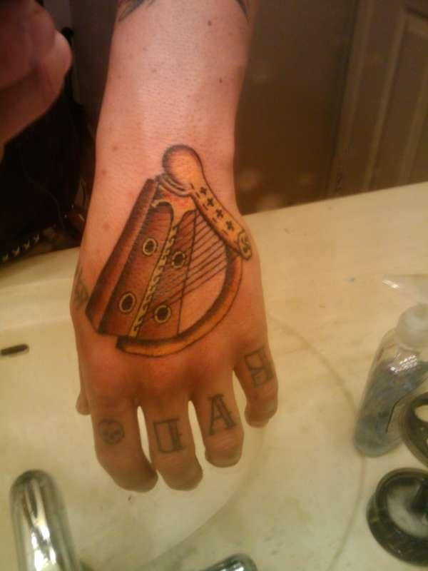 harp 40 Awesome Hand Tattoos