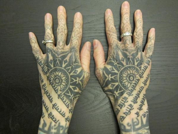 Sacred Hand Tattoo