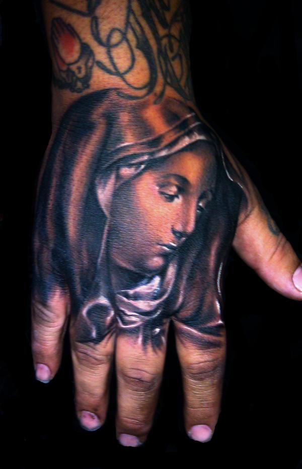 virgin mary 40 Awesome Hand Tattoos