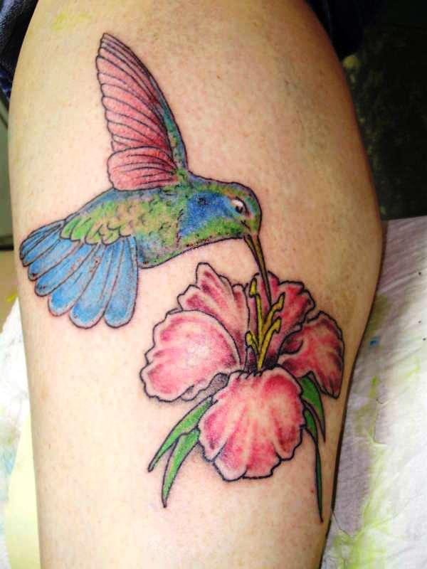 hummingbird with flower 35 Cool Hummingbird Tattoos
