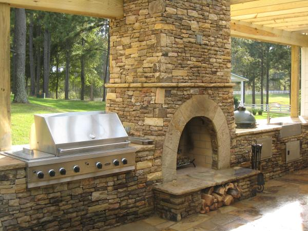 Stone Fireplace Outdoor Kitchen