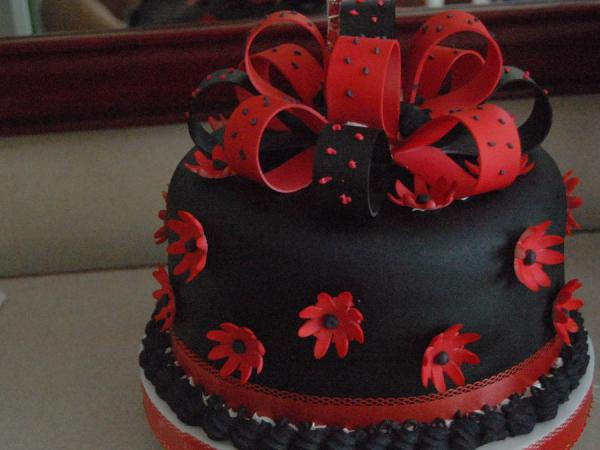 black cake with red flowers 30 Yummy Pictures of Cakes
