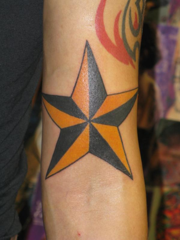 Yellow Black Star On Hand