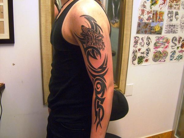 wolf tribal tattoo on arm Tattoos SloDive  Groovy Arm Tribal 30