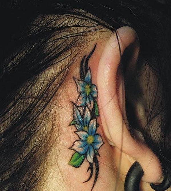 tribal flowers behind ear tattoo 30 Sexy Tribal Tattoos For Women